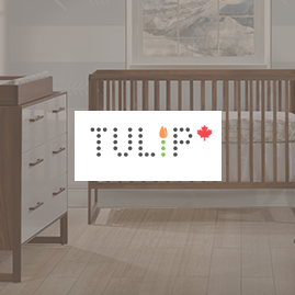 Baby nursery with wooden crib dresser and changing tray background with the tulip logo