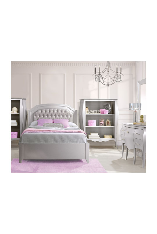 White bedroom with grey bookcases, double bed with silver diamond tufted upholstered panel with pink area rug