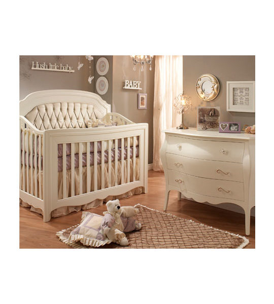 Baby room with classic 3 drawer dresser and crib with diamond tufted upholstered panel in platinum