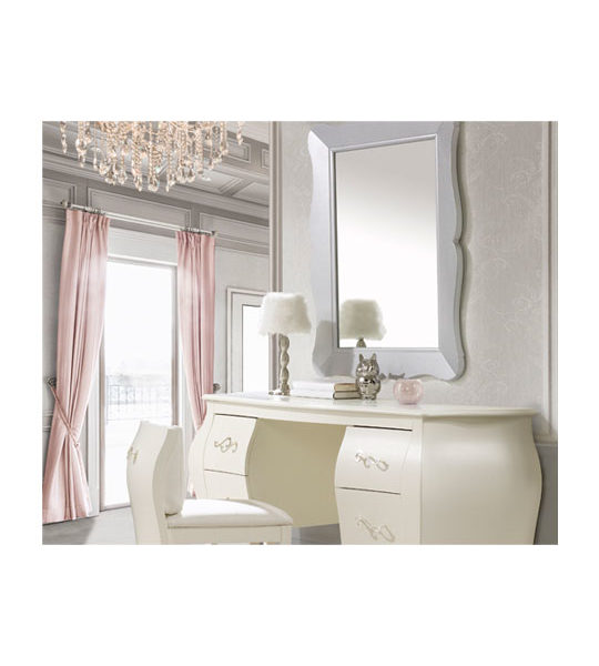 Light grey room with pink curtains, a chandelier, desk and vanity with pull out chair