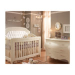 Baby room with classic 3 drawer dresser and crib with diamond tufted upholstered panel in WHITE