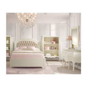 White teen girl's room with white desk/vanity, two bookcases, a double bed with pink sheets and gold diamond tufted upholstered panel, and a big chandelier