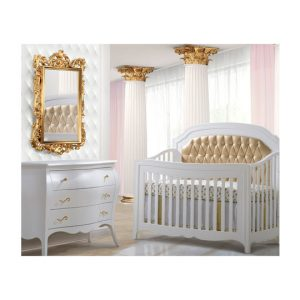 White and gold baby nursery with white dresser with gold knobs, white crib with gold diamond tufted upholstered panel