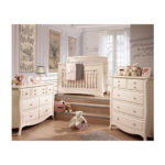 Baby nursery with white double dresser, 5 drawer dresser and steps leading up to crib