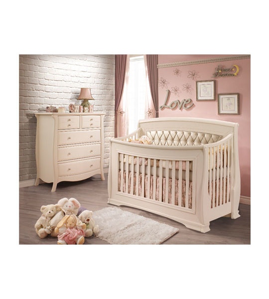 Pink Baby Room with a white brick wall, a dresser and crib in linen