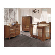 White nursery with airplane mobile, world map wallpaper and brown wooden armoire, double dresser and crib with platinum diamond tufted upholstered panel