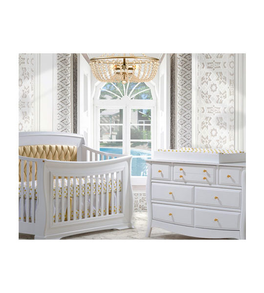 White and gold baby nursery with white double dresser with gold knobs, white crib with gold diamond tufted upholstered panel