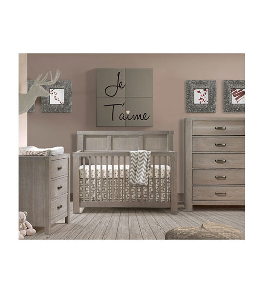 Dark bedroom with wooden floors and wooden 3 drawer dresser, 5 drawer dresser and crib