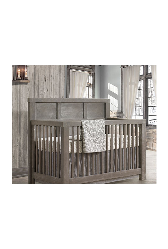 Rustic Baby nursery with wood panelled wall, and a dark wood convertible crib