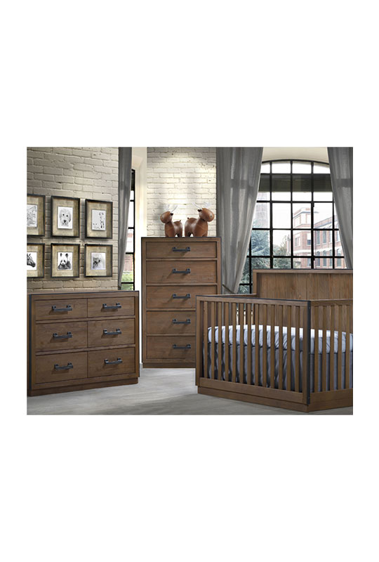 Baby nursery with grey floors, brick walls, dark brown wood crib, double dresser, 5 drawer dresser with black handles