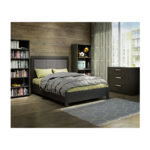 Dark wood bedroom with wood panelled walls, black wooden double bed with grey upholstered headboard panel with green sheets, 3 drawer dresser, bookcases