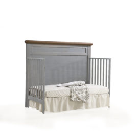 "Cortina ""5-in-1"" grey wood Convertible Crib with brown tops turned into a daybed"