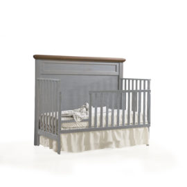 "Cortina ""5-in-1"" grey wood Convertible Crib with brown tops turned into a toddler bed with toddler gates"
