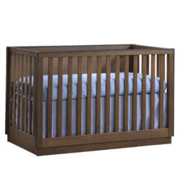 Sevilla dark brown wood convertible crib with black edges and blue sheets