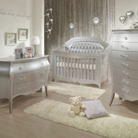 Baby nursery with silver 3 drawer dresser, 5 drawer dresser and crib with silver diamond tufted panel