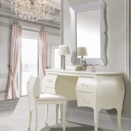 Grey bedroom with chandelier, pink curtains and classic desk and vanity with pull out chair