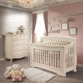 Pink Baby Room with a white brick wall, a dresser and crib in linen with platinum diamond tufted upholstered panel