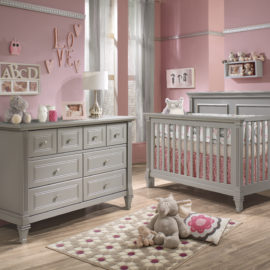 Pink baby nursery with a crib and double dresser in elephant grey