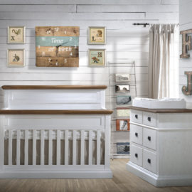 White Bedroom with wood panelled walls, white classic wooden crib and double dresser with cognac tops with a white wooden changing tray