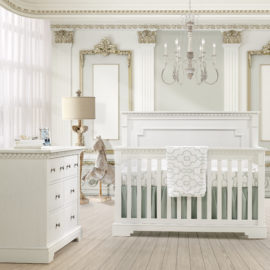 White regal Baby Room with white double dresser and crib