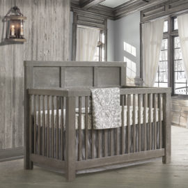 "Grey baby room with wooden walls and floors and a wooden ""5-in-1"" Convertible Crib"