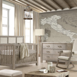 Baby Room in Sugar Cane with grey wooden crib with beige upholstered panels, grey double dresser and rocking chair with beige cushions