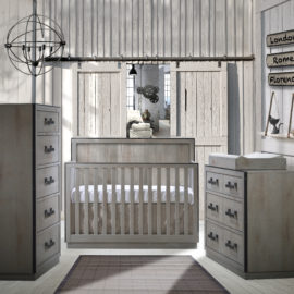 Rustic bedroom with wooden walls featuring a wooden crib in grey chalet with a 5 drawer dresser, double dresser and changing tray