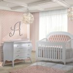 Baby Girl nursery with pink walls and curtains and featuring a Convertible Crib with blush diamond tufted panel & Double Dresser in white featuring Matty in soft pink
