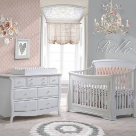 Baby room with a pink wallpaper and grey painted wall, featuring a white Convertible Crib with blush diamond tufted panel, Double Dresser & Changing Tray in white