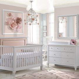 Pink baby room with floral decorations and a white Convertible Crib with blush upholstered panel, Double Dresser & Changing Tray in white