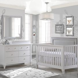 Grey baby room with flower wallpaper, featuring a white Convertible Crib with linen grey upholstered panel, Double Dresser & Changing Tray in white