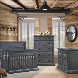 Baby Room with wooden walls and ceiling, featuring a double dresser, 5 drawer dresser and crib in black chalet wooden color