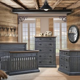 Baby Room with wooden walls and ceiling, featuring a double dresser, 5 drawer dresser and crib in black chalet color with cognac tops