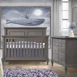 Baby room with grey walls and blue whale picture with a convertible Crib & Double Dresser in grigio