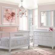 """Pink nursery with a white """"5-in-1"""" Convertible Crib with Channel Tufted Upholstered Headboard Panel in Blush, a double dresser and a white changing tray"""