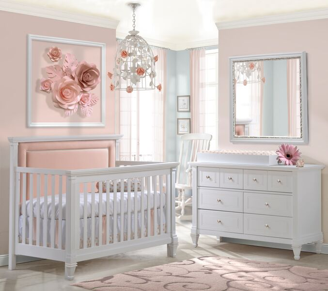 "Pink nursery with a white ""5-in-1"" Convertible Crib with Channel Tufted Upholstered Headboard Panel in Blush, a double dresser and a white changing tray"