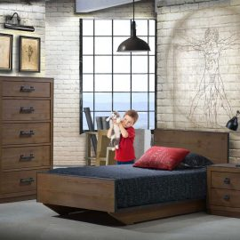 Kids bedroom with white brick walls and Sevilla furniture in dark brown (cognac), featuring a twin bed, nighstand and 5 drawer dresser with a little boy holding a cat