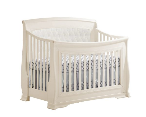 Beige classic crib with white upholstered diamond tufted panel