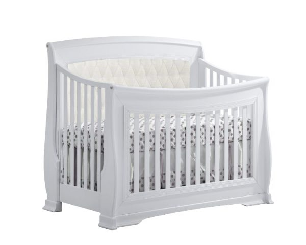 White classic crib with white upholstered diamond tufted panel