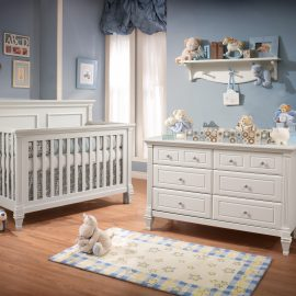 Blue Baby Room with White crib and double dresser with blue teddy bears