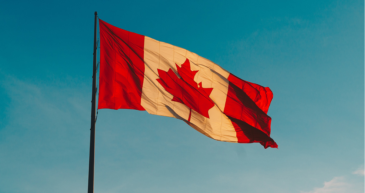 canada flag and blue skies
