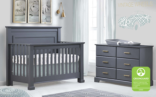 Nursery with charcoal colored crib and double dresser with a grey changing mat