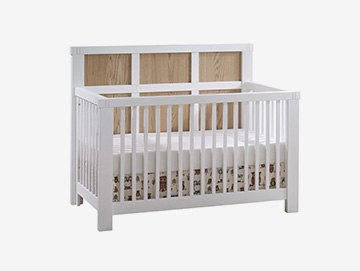 White and natural colored wood panels crib