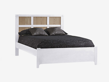 White double bed with natural wood colored panels and black sheets