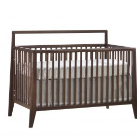 Baby crib with dark brown wooden frame and white headboard