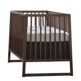 baby crib with a dark brown wood frame