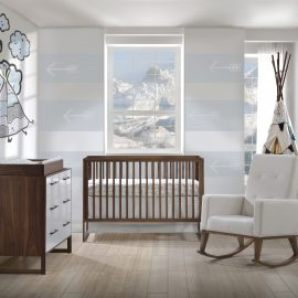 Baby room with white and dark wood furniture