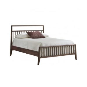 Double bed with dark wood frame and white headboard