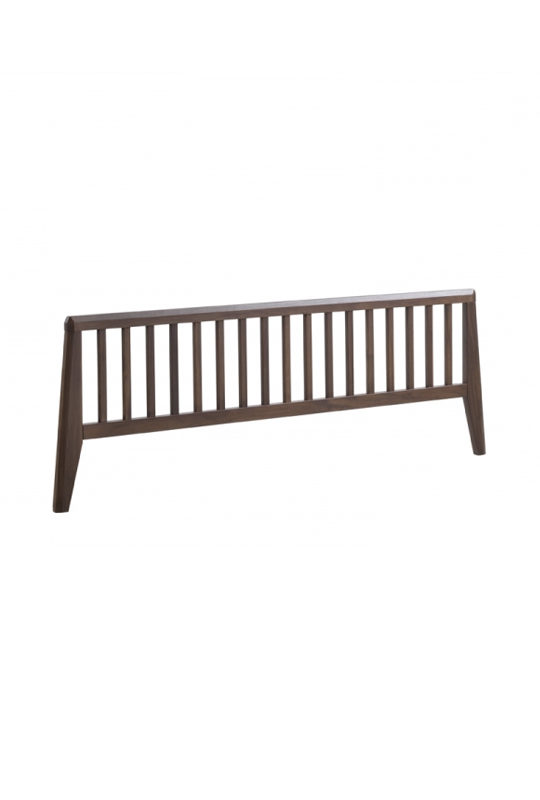 Dark wood bed footboard