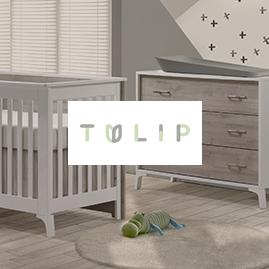 nursery image of crib and dresser with tulip brand logo